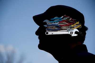Photo: Profile of a man with tools on his mind.