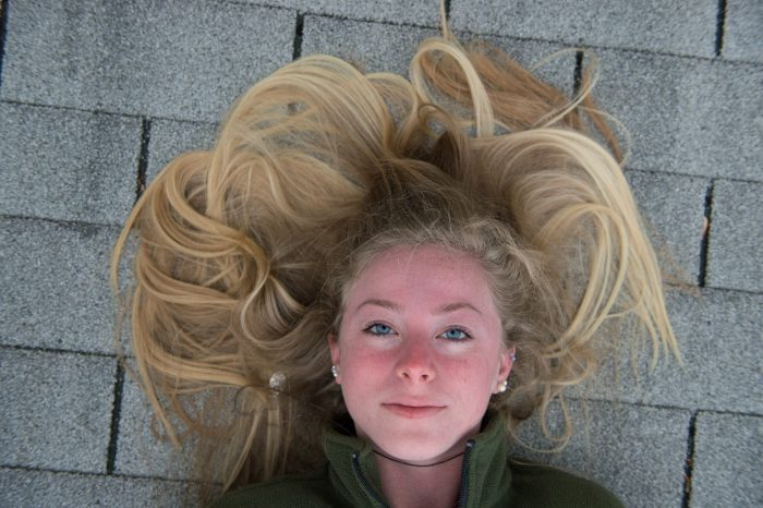 Photo: A teenage girl laying on the roof of her grandparent's house.