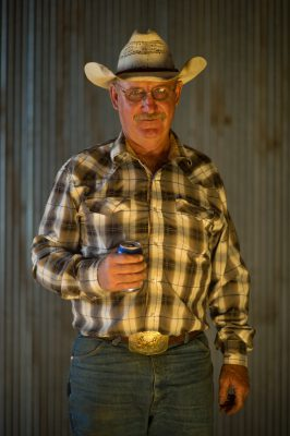 Photo: A portrait of a man wearing a cowbody hat.