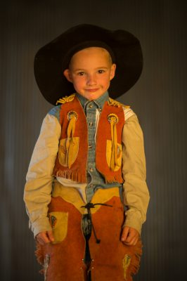 Photo: A portrait of an elementary age boy wearing a cowboy hat.