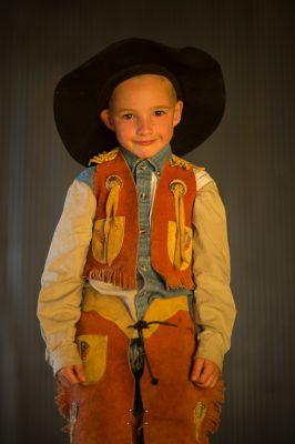Photo: A portrait of an elementary age boy wearing a cowboy hat.