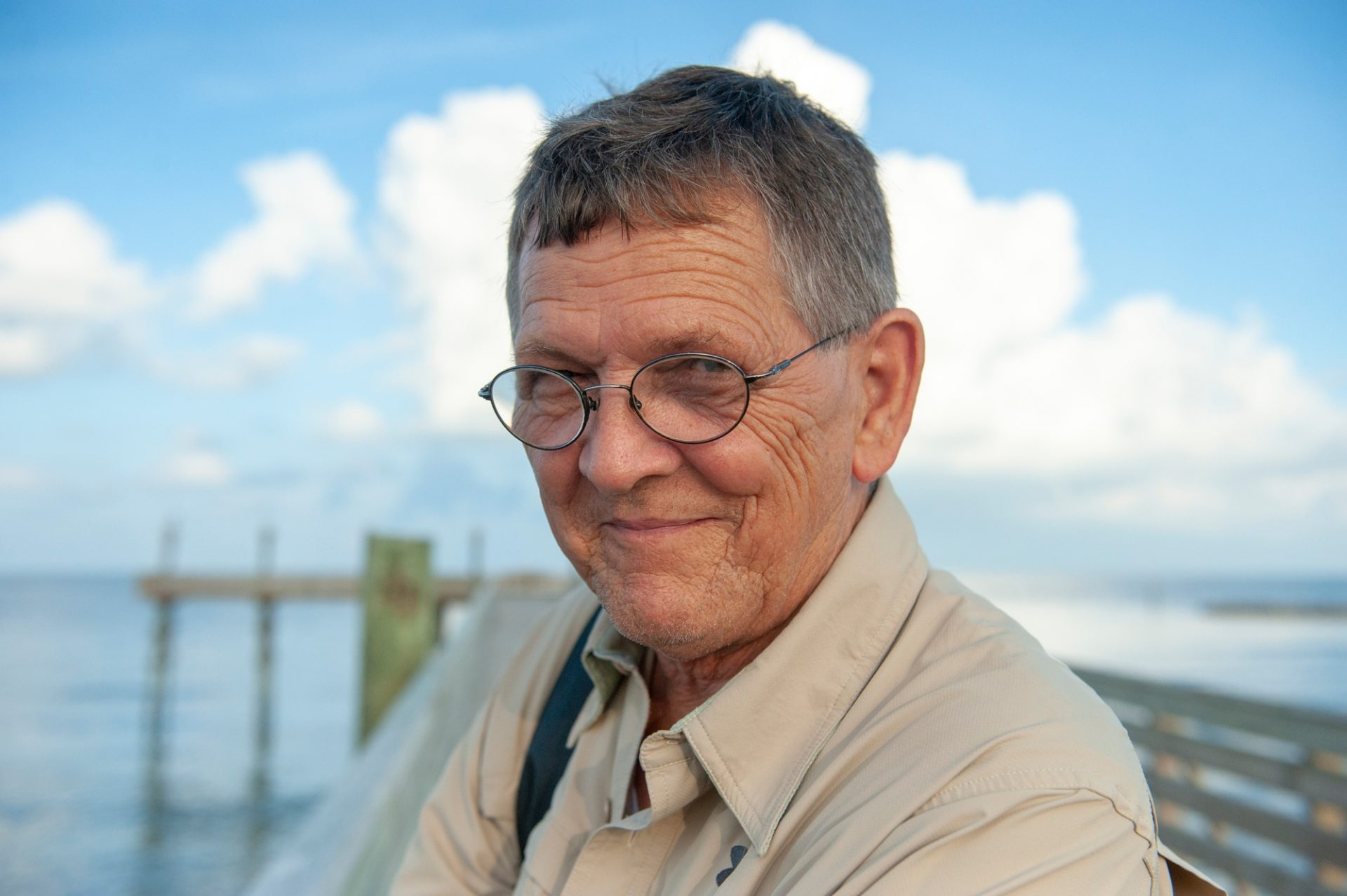 Photo: A portrait of a man on the dock at Grand Isle, Louisiana.