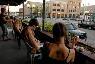 Photo: People enjoy coffee at the popular coffee house, The Mill, in Lincoln's historic Haymarket Square.
