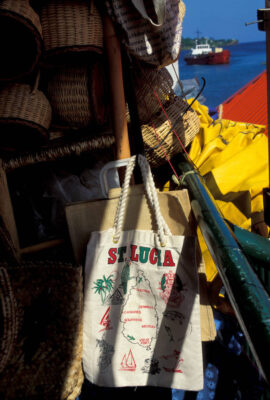 Photo: Baskets and a bag hanging in a market in St. Lucia in the Caribbean.