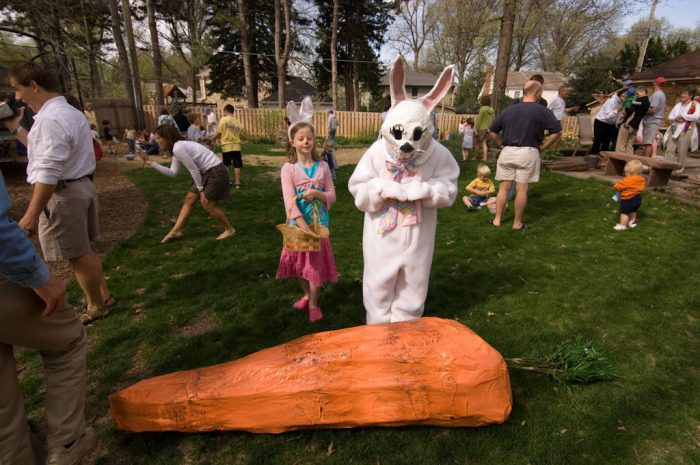Photo: The Easter Bunny stands by a giant carrot as children search for Easter eggs in Lincoln, Nebraska.
