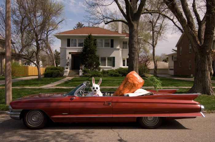 Photo: The Easter Bunny rides in style in his red 1961 Cadillac.