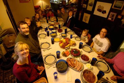 Photo: A family sits down to dinner during the holidays.