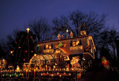 Photo: A home in Lincoln is decked out in Christmas lights and figurines.