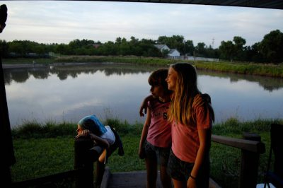 Photo: Three girls near the lake at the Fenton Family Farm in Greenleaf, Kansas.