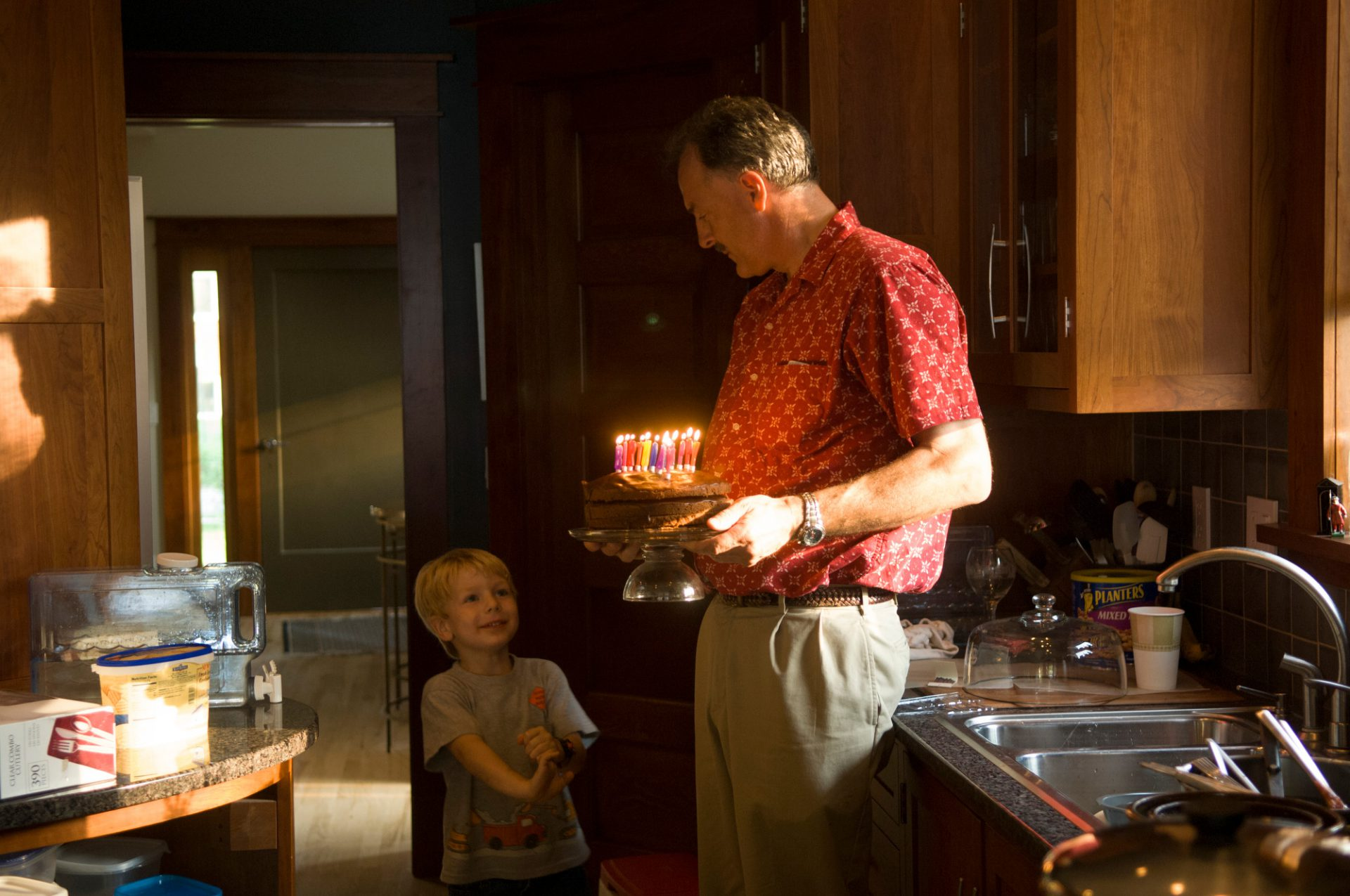 Photo: A man lights candles in celebration of his brother's 50th birthday.