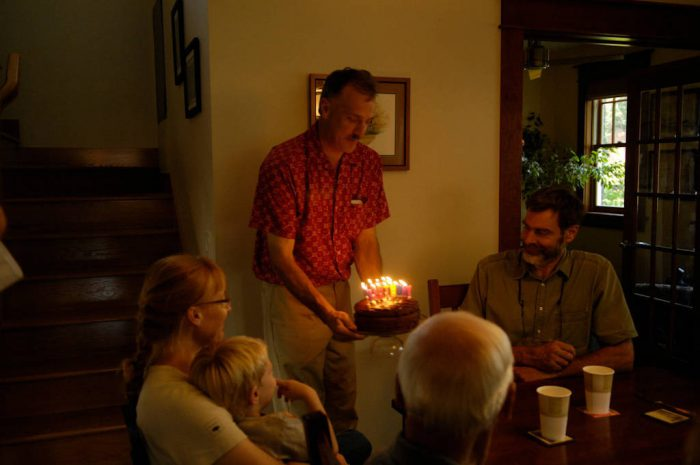 Photo: A man celebrates his 50th birthday with his friends and family.