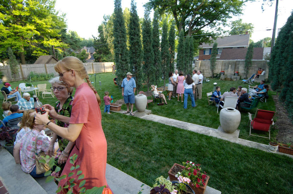 Photo: Friends and family gather to celebrate a man's 50th birthday.