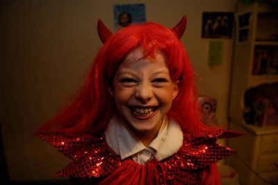 Photo: A girl, dressed as a devil for halloween, mugs for the camera in Lincoln, Nebraska.