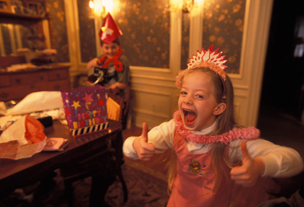 Photo: A young girl show her enthusiasm at a birthday party in Lincoln, Nebraska.