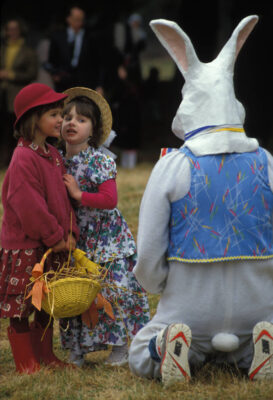 "Photo: In Connecticut, two young girls in their ""Sunday Best"" are reluctant to socialize with the Easter bunny."