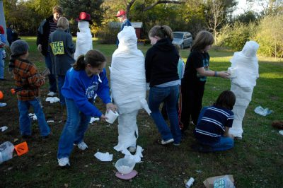 Photo: A Halloween party on a farm near Ashland, NE., features a mummy contest.