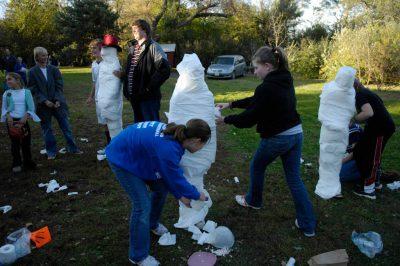 Photo: A Halloween party on a farm near Ashland, NE., features a mummy contest.