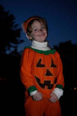 Photo: A 4-year-old boy wears a pumpkin costume for Halloween.