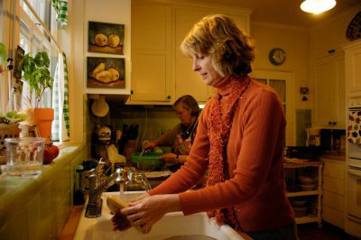 Photo: A woman washes dishes after a Thanksgiving meal.