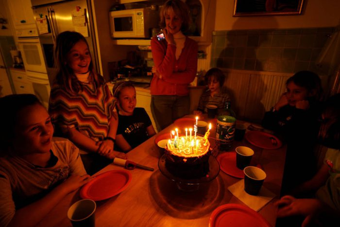 Photo: An 11-year-old girl celebrates her birthday with friends and family.