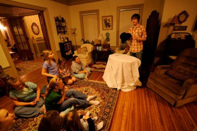 Photo: A boy performs a magic show for his 11-year-old sister's birthday party.
