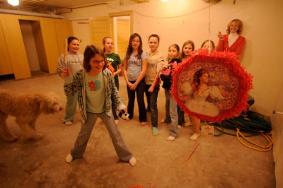 Photo: An 11-year-old girl celebrates her birthday with a princess pinata