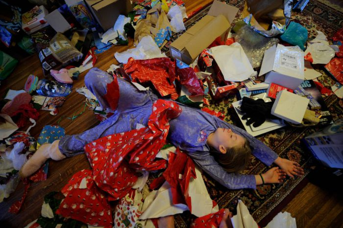 Photo: A family's living room is filled with trash from holiday festivities.