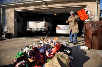 Photo: A man disposes of Christmas garbage after the holidays.