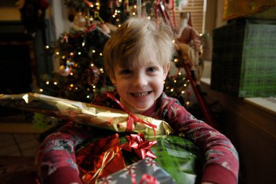 Photo: A boy with his Christmas presents.
