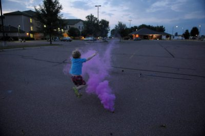 Photo: A boy lights fireworks in Walker, Minnesota.