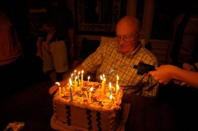 Photo A Senior Man At His 80th Birthday Party