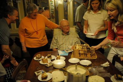Photo: A senior man at his 80th birthday party.