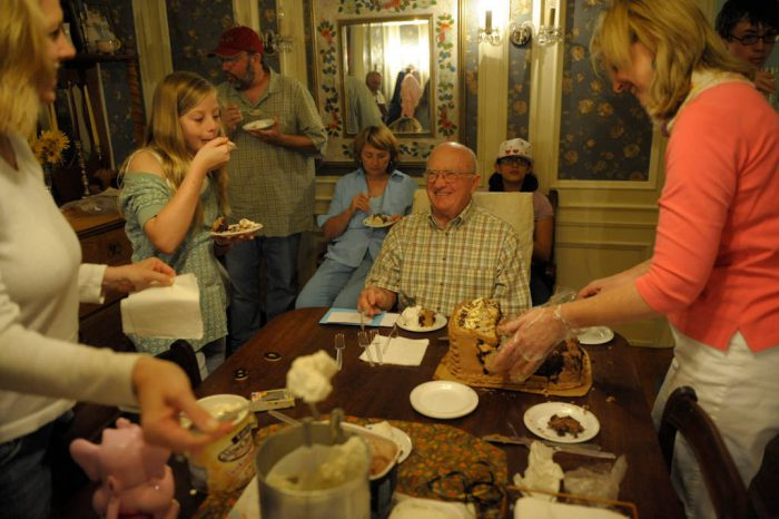 Photo: A senior man at his 80th birthday party.