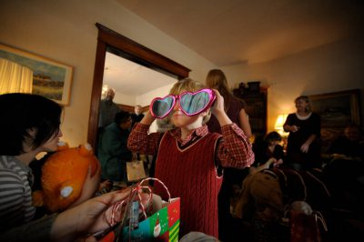 Photo: A family opens presents on Christmas morning.