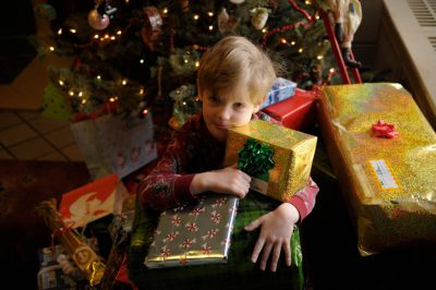 Photo: A five year-old boy with his presents on Christmas morning.