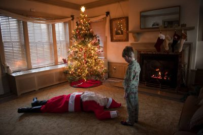 Photo: A young boy stumbles across a dead santa.