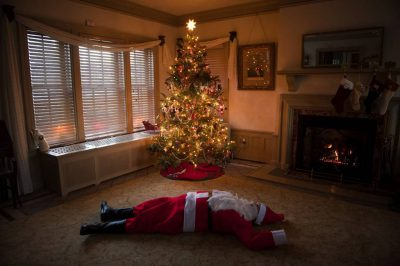 Photo: Santa sprawled out across a living room floor.