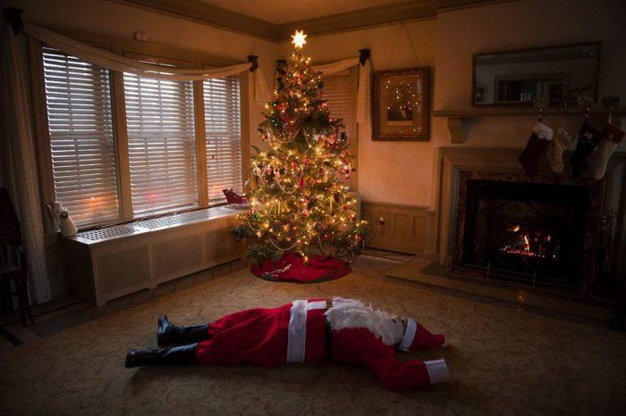 Photo: Santa sprawled out across a living room floor.
