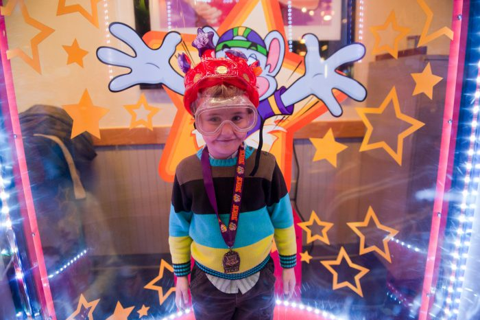 Photo: A child plays a game at his birthday party at Chuck E. Cheese's in Lincoln, Nebraska.