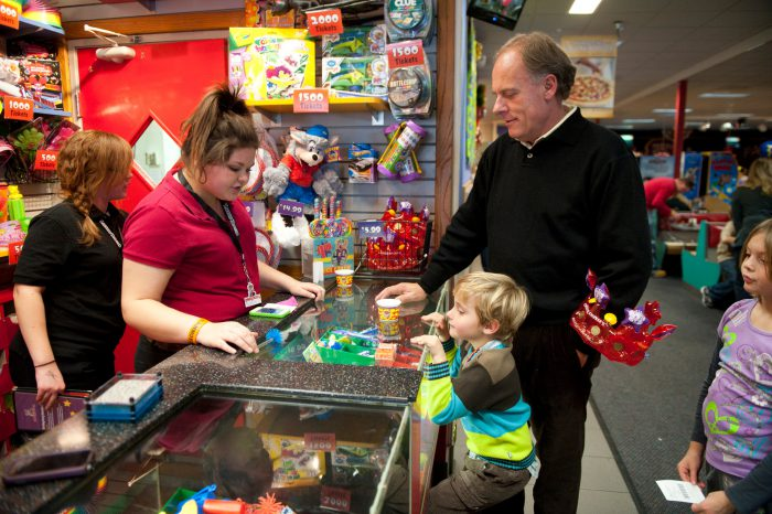 Photo: A child redeems his tickets at his birthday party at Chuck E. Cheese's in Lincoln, Nebraska.