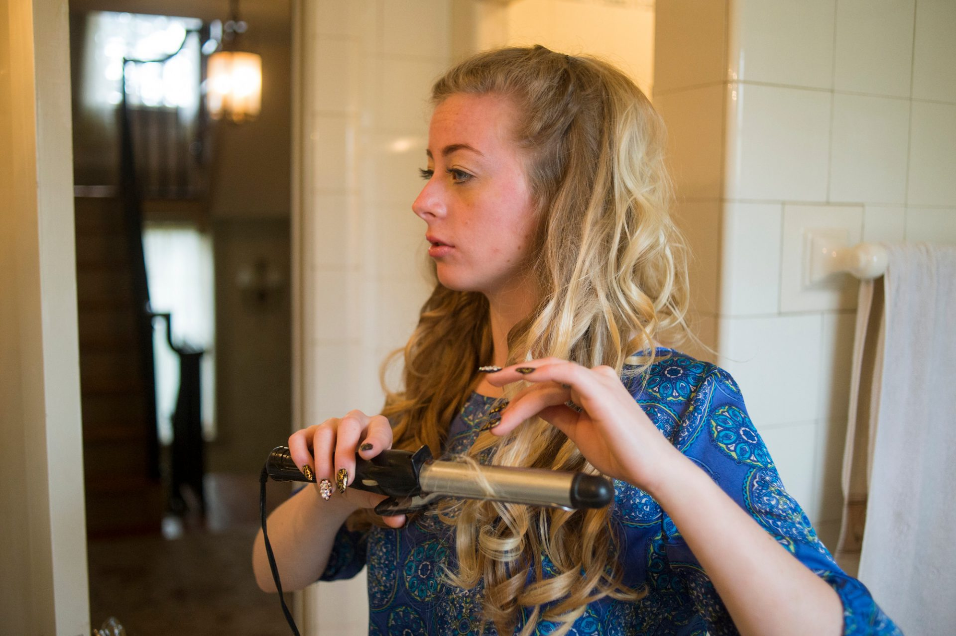 Photo: A teenage girl, gets ready for her senior prom.