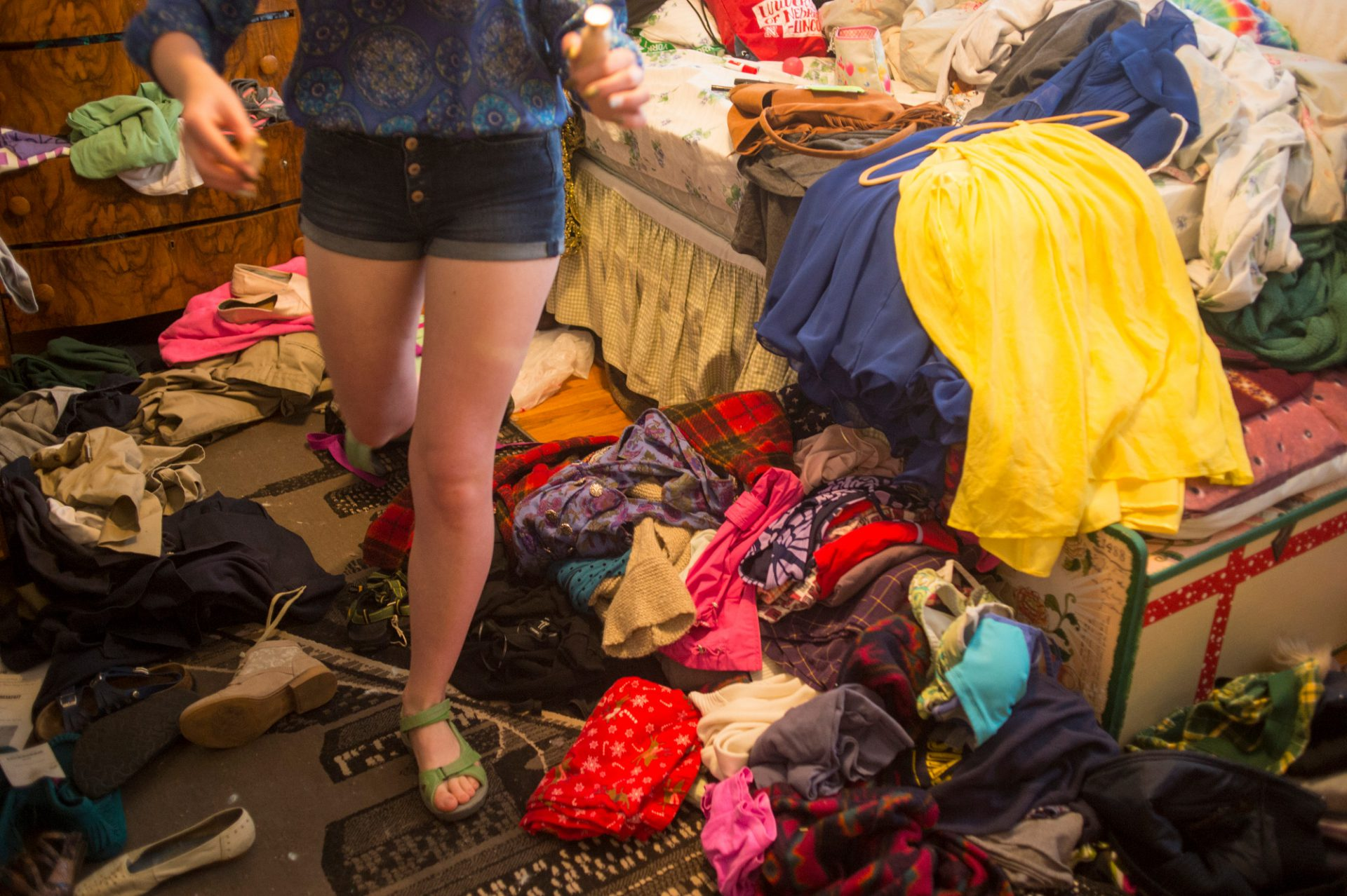 Photo: A teenage girl walks through her bedroom.