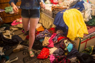 Photo: A teenage girl walks through her bedroom.