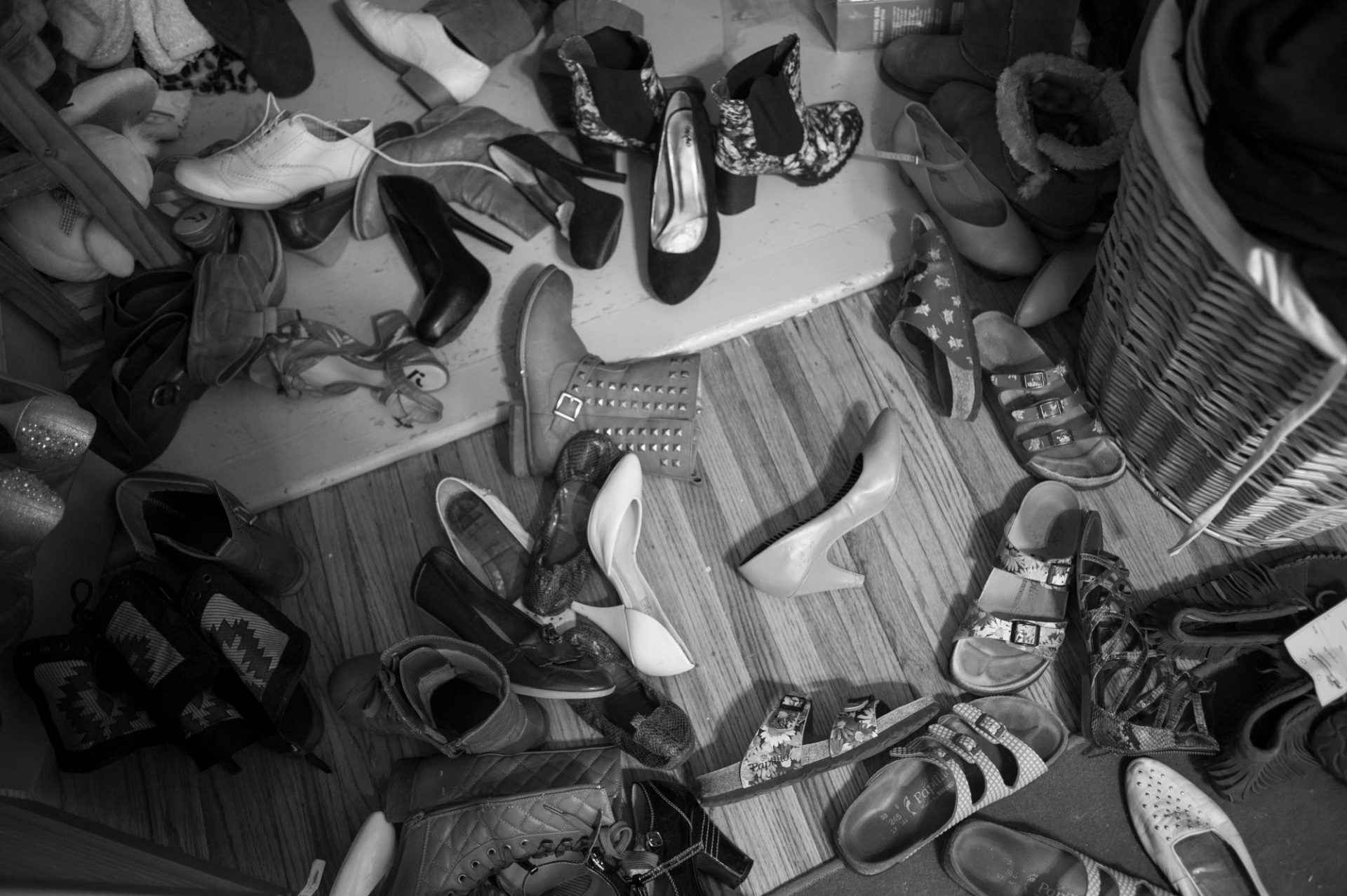 Photo: Shoes on the floor of a teenage girl's bedroom.