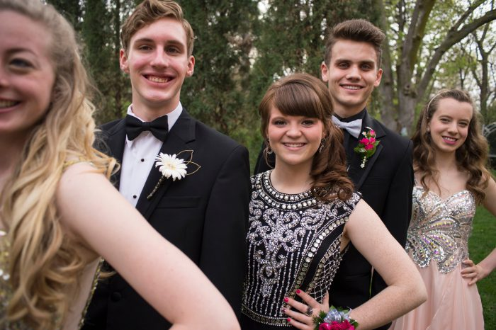 Photo: Teenagers getting their pictures taken before heading to their senior prom.