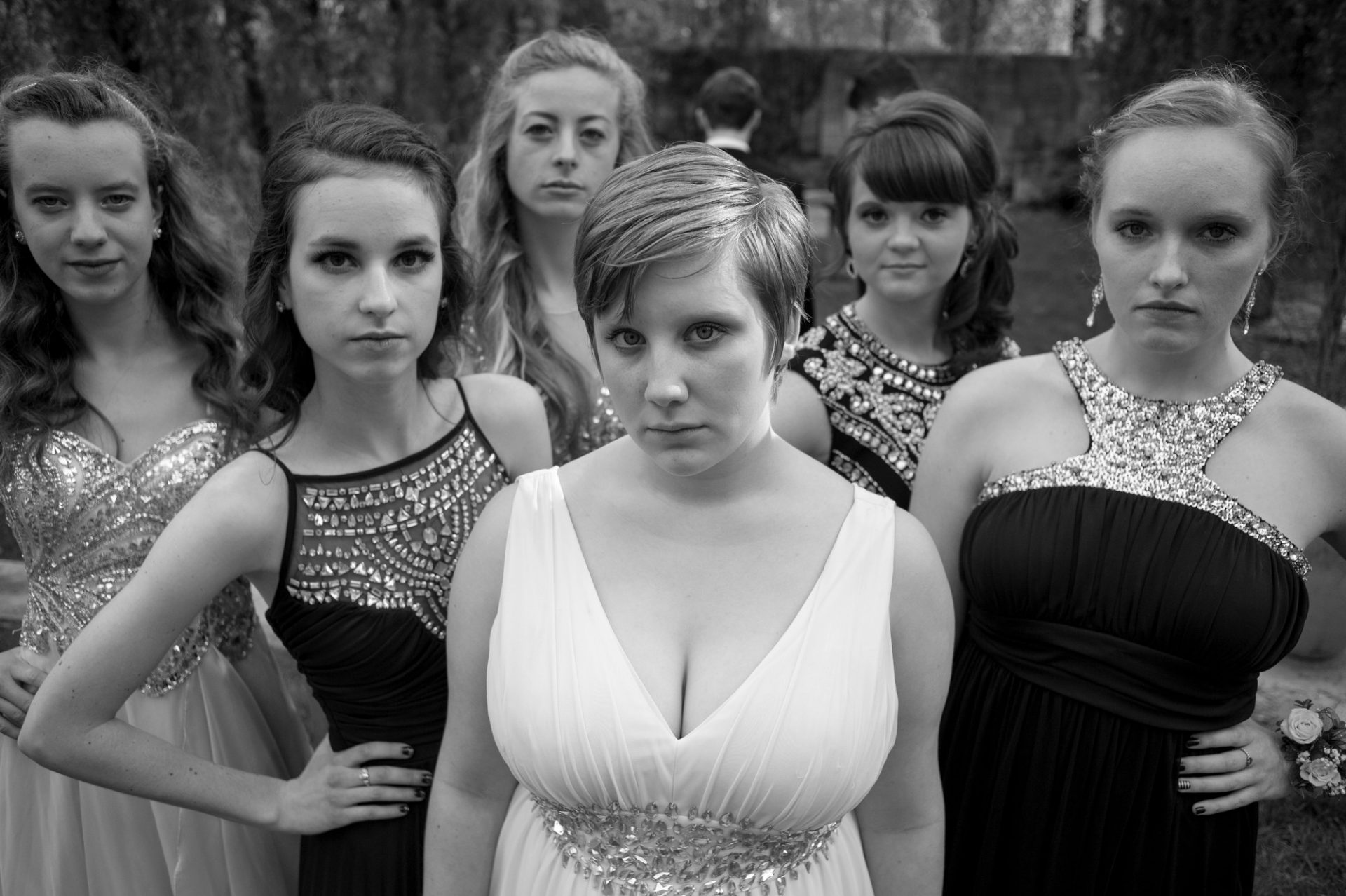 Photo: Teenagers pose for portraits before heading to their senior prom.