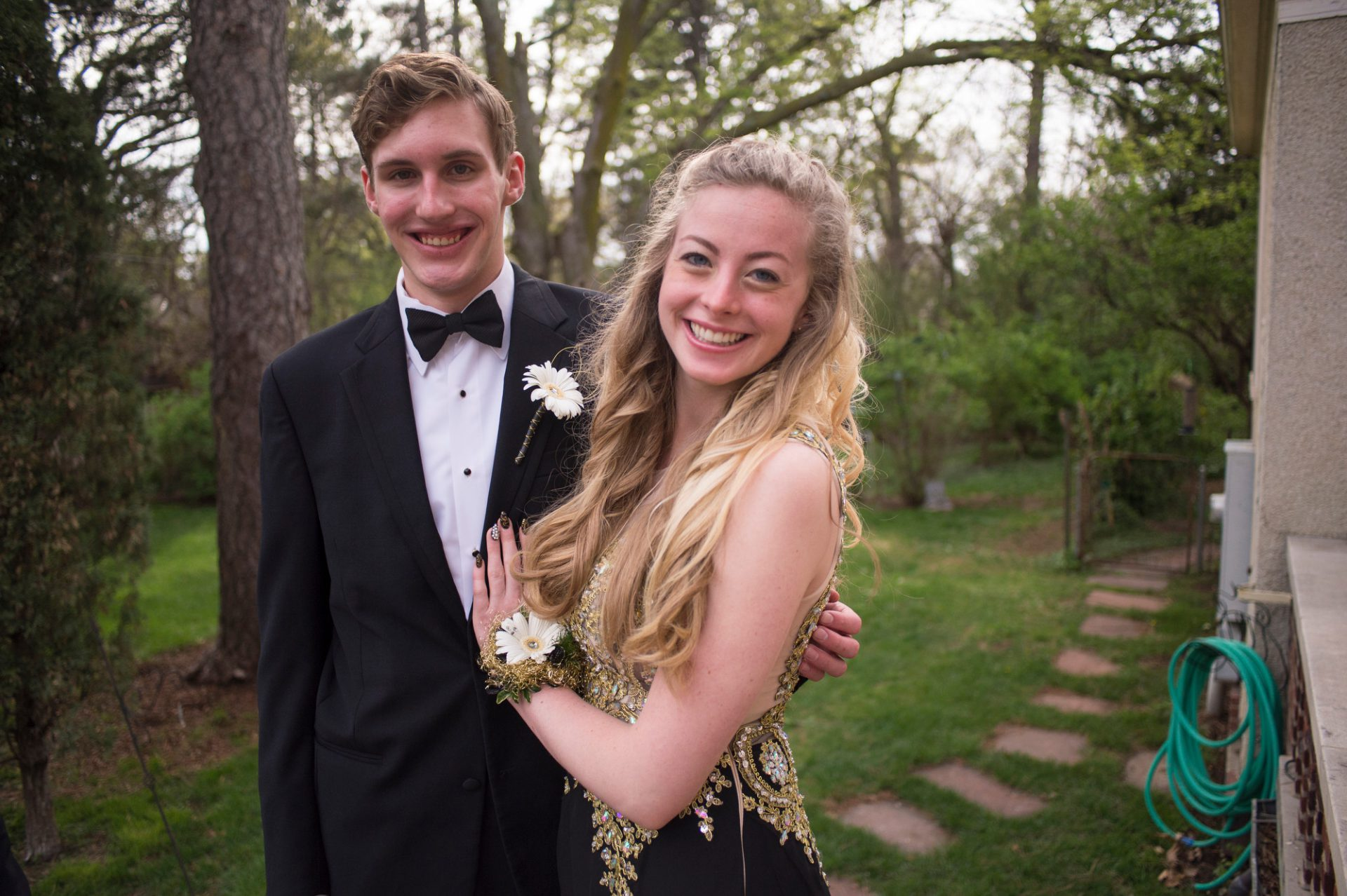 Photo: Two teenagers pose for portraits before heading to their senior prom.