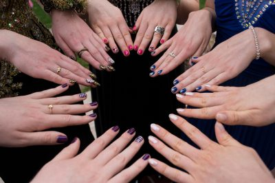 Photo: Teenage girls show their painted fingernails before heading to their senior prom.