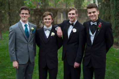 Photo: Teenage boys pose for portraits before heading to their senior prom.