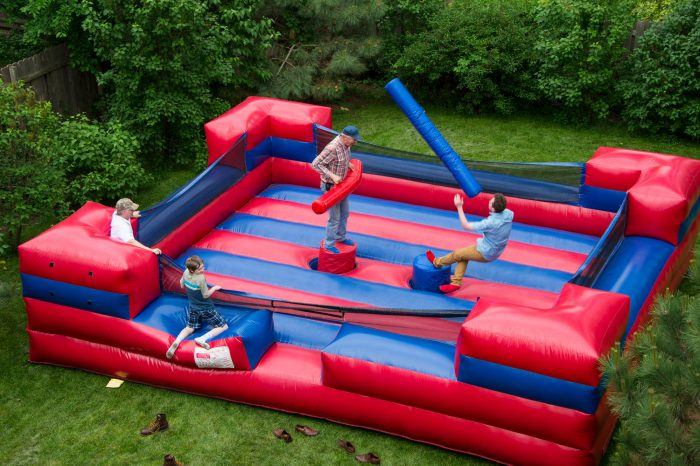 Photo: Two men battle in an inflatable jousting ring.